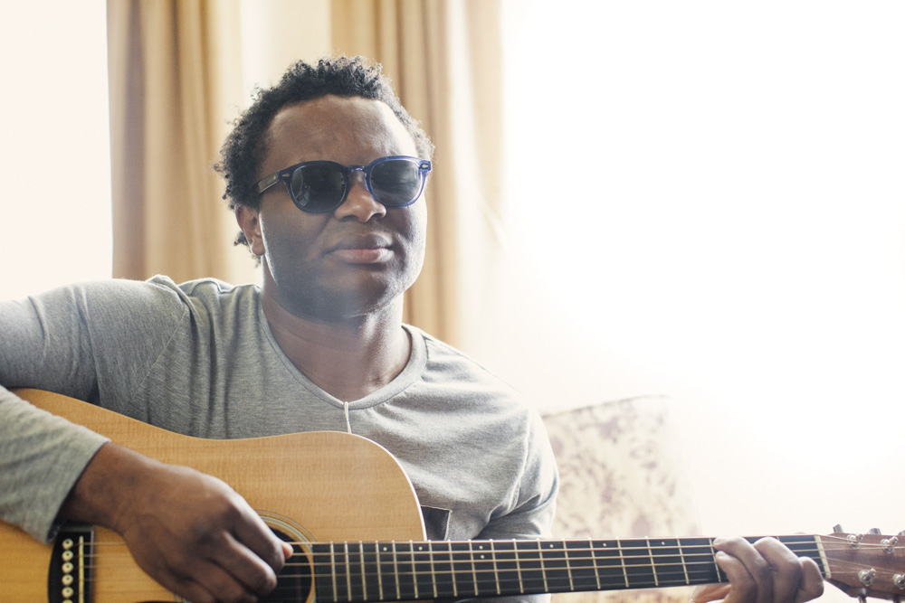 The Voice Contestant Blessing Offor playing his guitar. Photography by Rob Springer