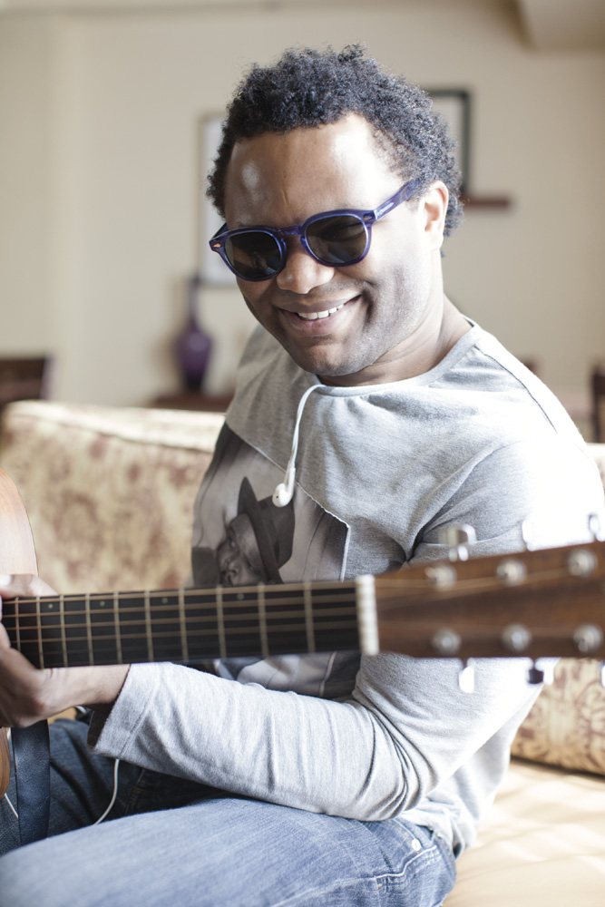 The Voice Contestant Blessing Offor playing his guitar