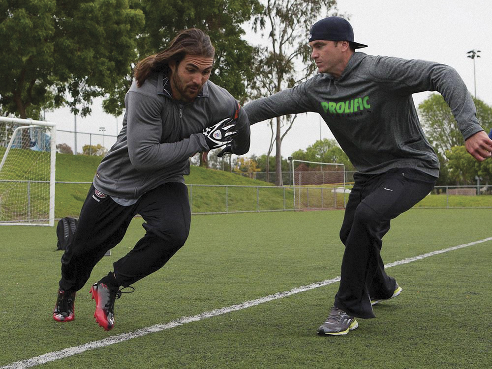 Brett Swain, a wide receiver for the Green Bay Packers, working on speed training with Ryan Flaherty