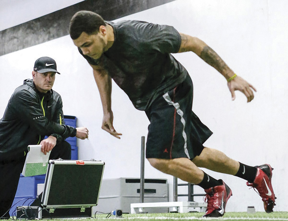 Ryan Flaherty working with Mike Evans, a former star receiver at Texas A&M
