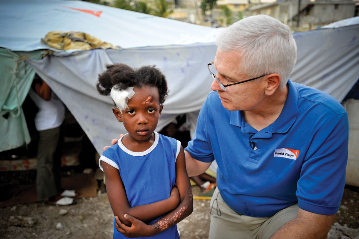 Rich Stearns with Magdalena (age 6), earthquake survivor at Place Accra IDP (Internally Displaced People) camp, Port au Prince, Haiti.