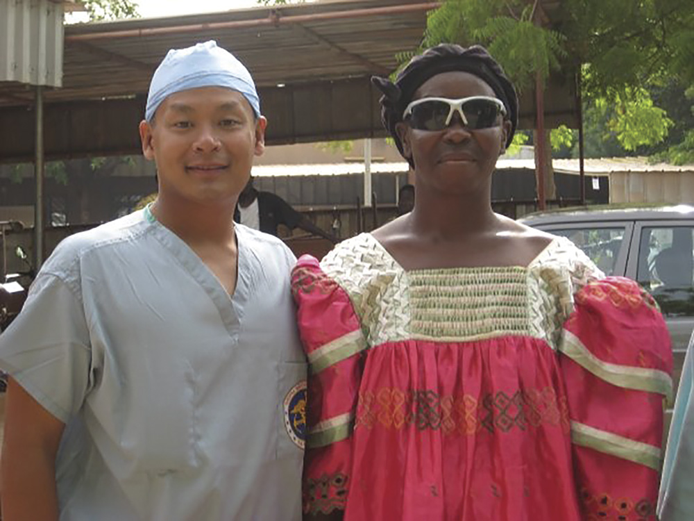 Prominent Doctor and Author Andrew Doan with patient he restored sight to