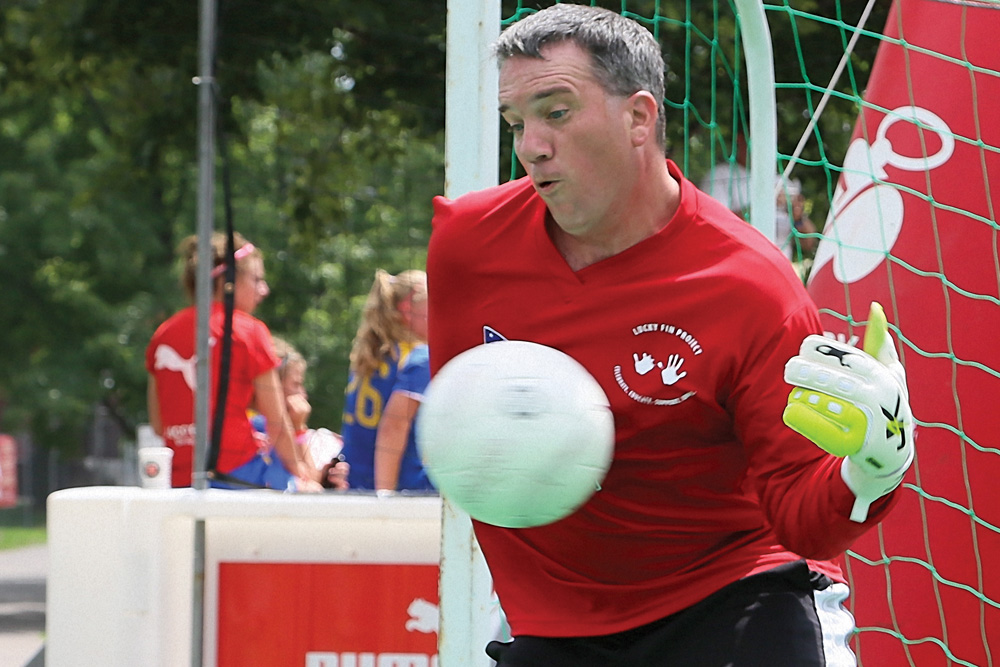 U.S. National Amputee Soccer Goalie Eric Westover stopping a ball with one arm. Photo by Carl Calabria