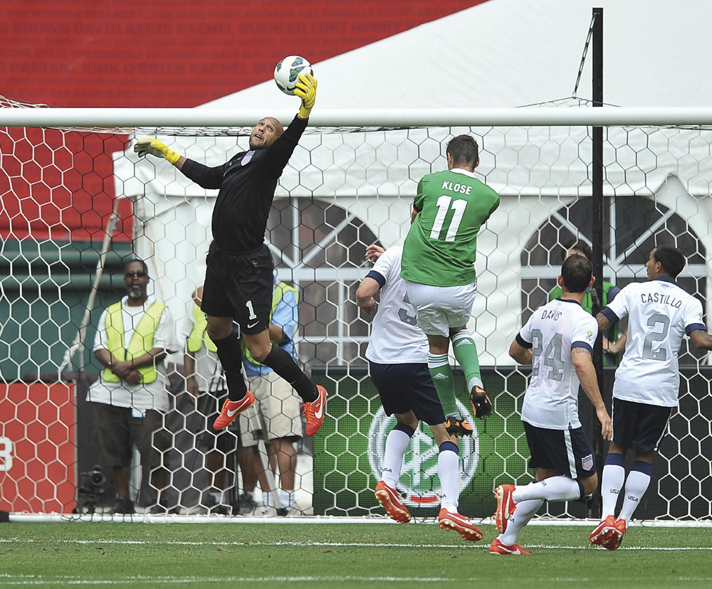 MLS Soccer Goalkeeper Tim Howard stretching out to save a goal. Photograph by Jose L. Argueta