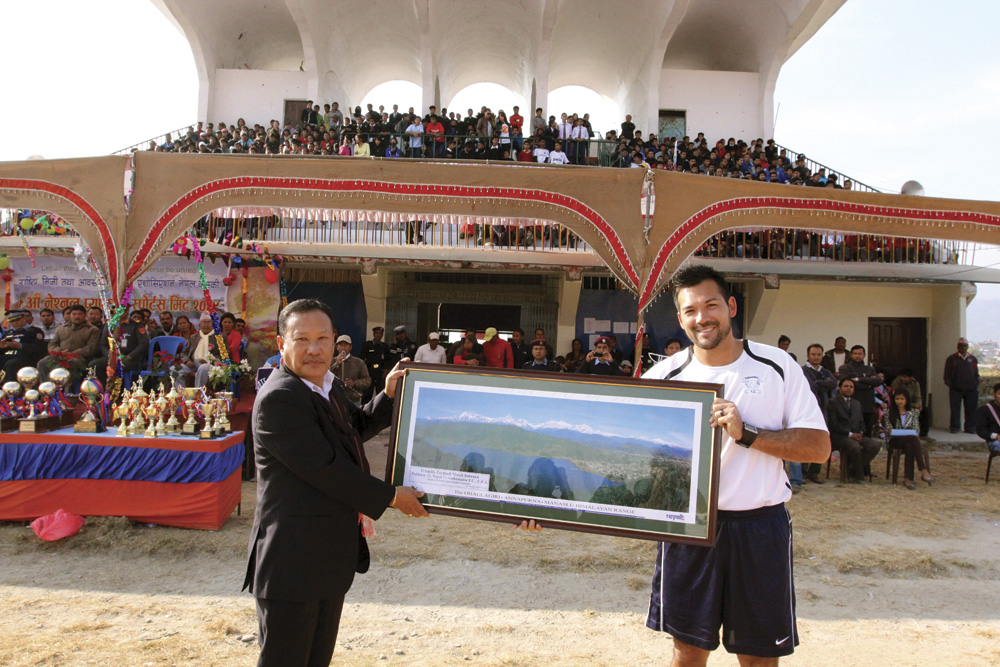 "Professional soccer player Aaron Tredway receiving the ""Token of Love"" prior to soccer match in Pokhara, Nepal (December 2012)."