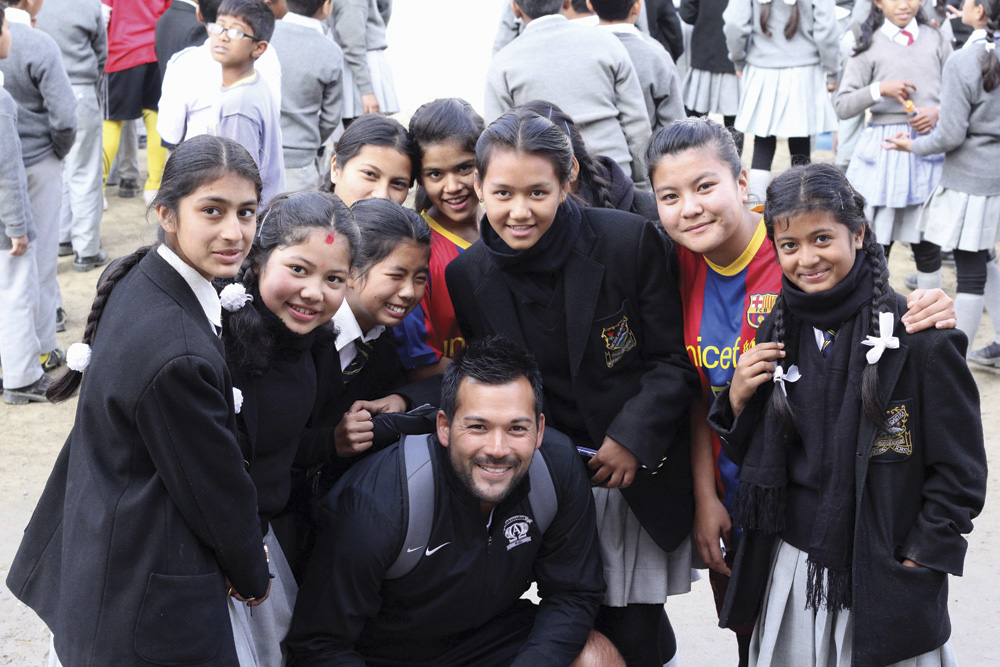 Professional soccer player Aaron Tredway visiting a local school Nepal.