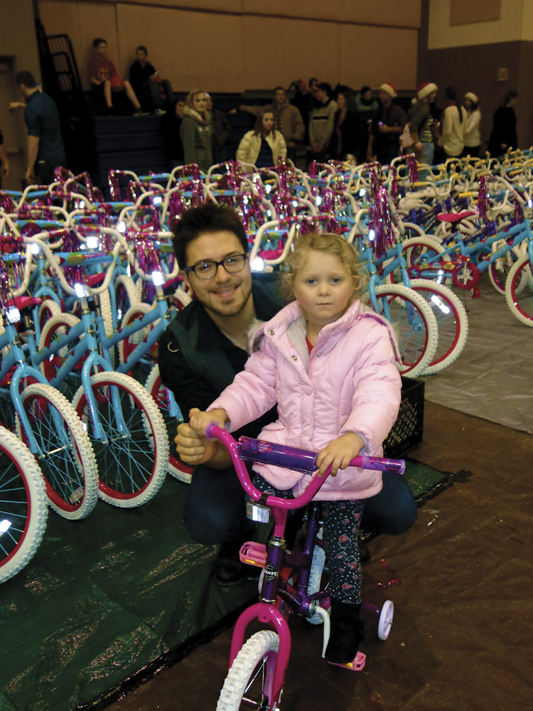 Danny Gokey at Destiny Christian Church in Rocklin, CA giving away 600 bikes to kids in need at Christmas.