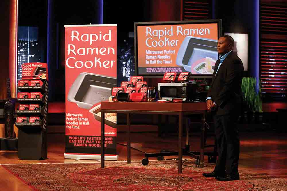 Chris Johnson pitching Rapid Ramen Cooker on Shark Tank.