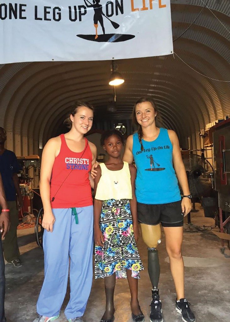 (l to r) Jessica, Moise - a 13-year-old below-the-knee amputee, and Christy. During their August 2016 trip they re-did Moise's whole leg set-up: socket, fit, etc.