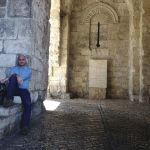 Tim Sisarich, Executive Director for Focus on the Family, sitting on the Eastern Gate to the old city in Jerusalem. Photograph courtesy of Focus on the Family