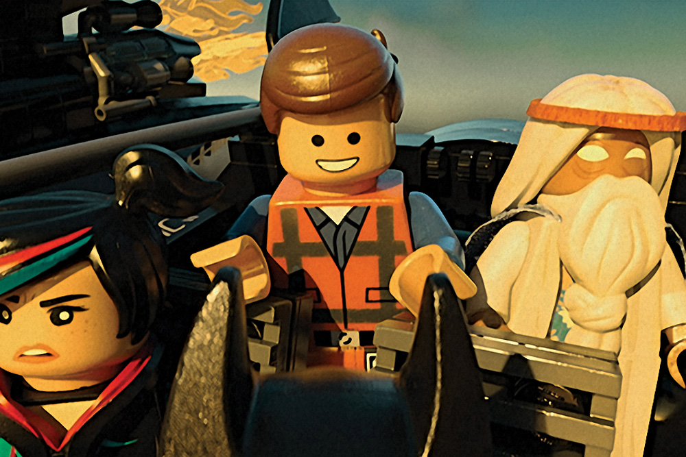 (L-r) LEGO® minifigures Wyldstyle (voiced by ELIZABETH BANKS), Emmet (CHRIS PRATT) and Vitruvius (MORGAN FREEMAN)