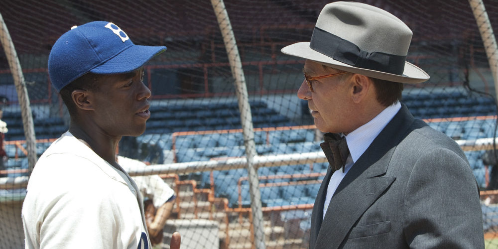 "Harrison Ford and Chadwick Boseman from ""42"" Jackie Robinson movie. © Legendary Pictures / Warner Bros"